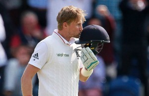 Joe Root of England kisses the 3 lions on his helmet after scoring a century.