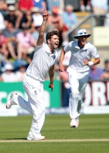 Mark Wood celebrates as he has Chris Rogers caught by Jos Buttler.